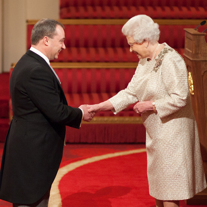 Queen Elizabeth II shaking hands with Prof Richard Wilding