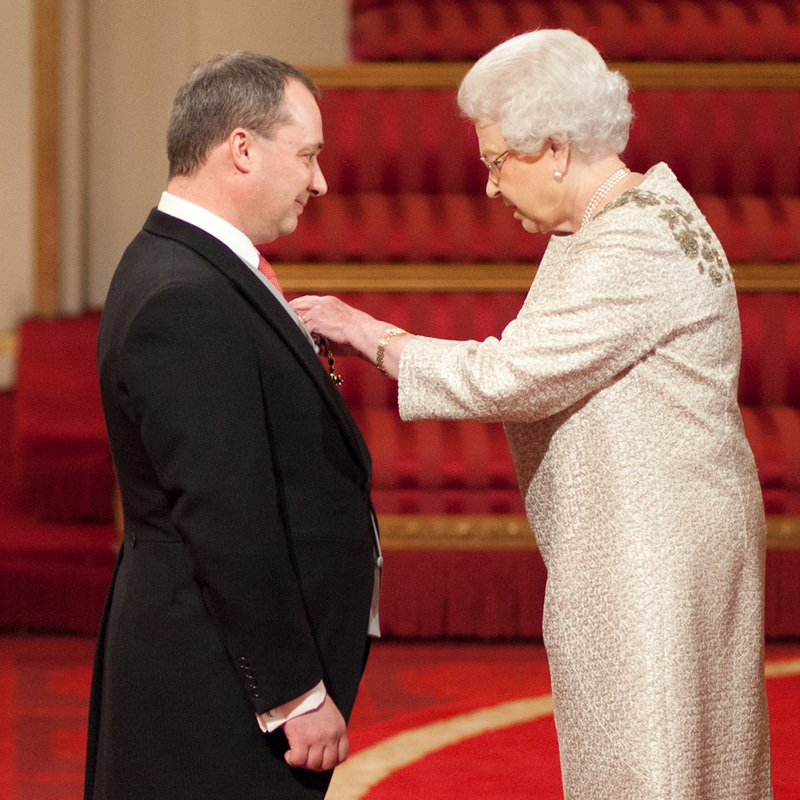 Prof Richard Wilding with Queen Elizabeth II receiving his OBE